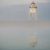 Lighthouse emerges from morning fog in Grand Marias