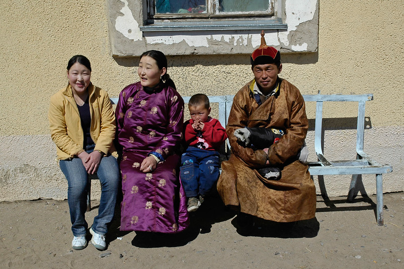 Portraits of family members outside a rural hospital in Central Mongolia.