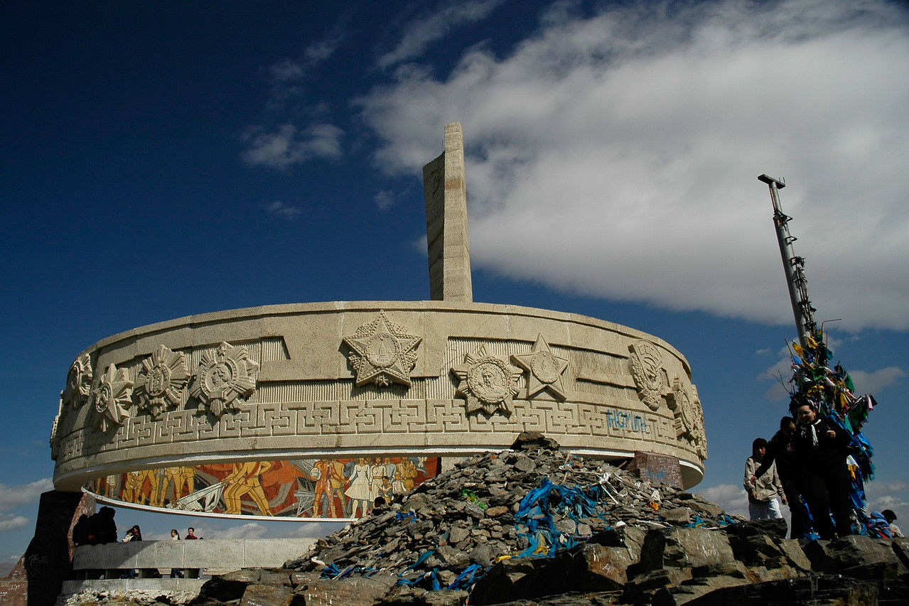 Zaisan Memorial. Located to the south side of Ulaanbaatar is Zaisan Hill Memorial which was erected on the occasion of 50th anniversary of Mongolia Independence and honors the Soviet and Mongolian soldiers who died in WWII in the fight against Japan and Nazi Germany. Next to the monumental statue of the soldier, a mosaic composition on a large circular panel in reinforced concrete illustrates the theme of friendship between Mongol and Soviet peoples. In the center of it a large granite bowl holds an eternal flame. The Memorial provides impressive view over the whole capital city.