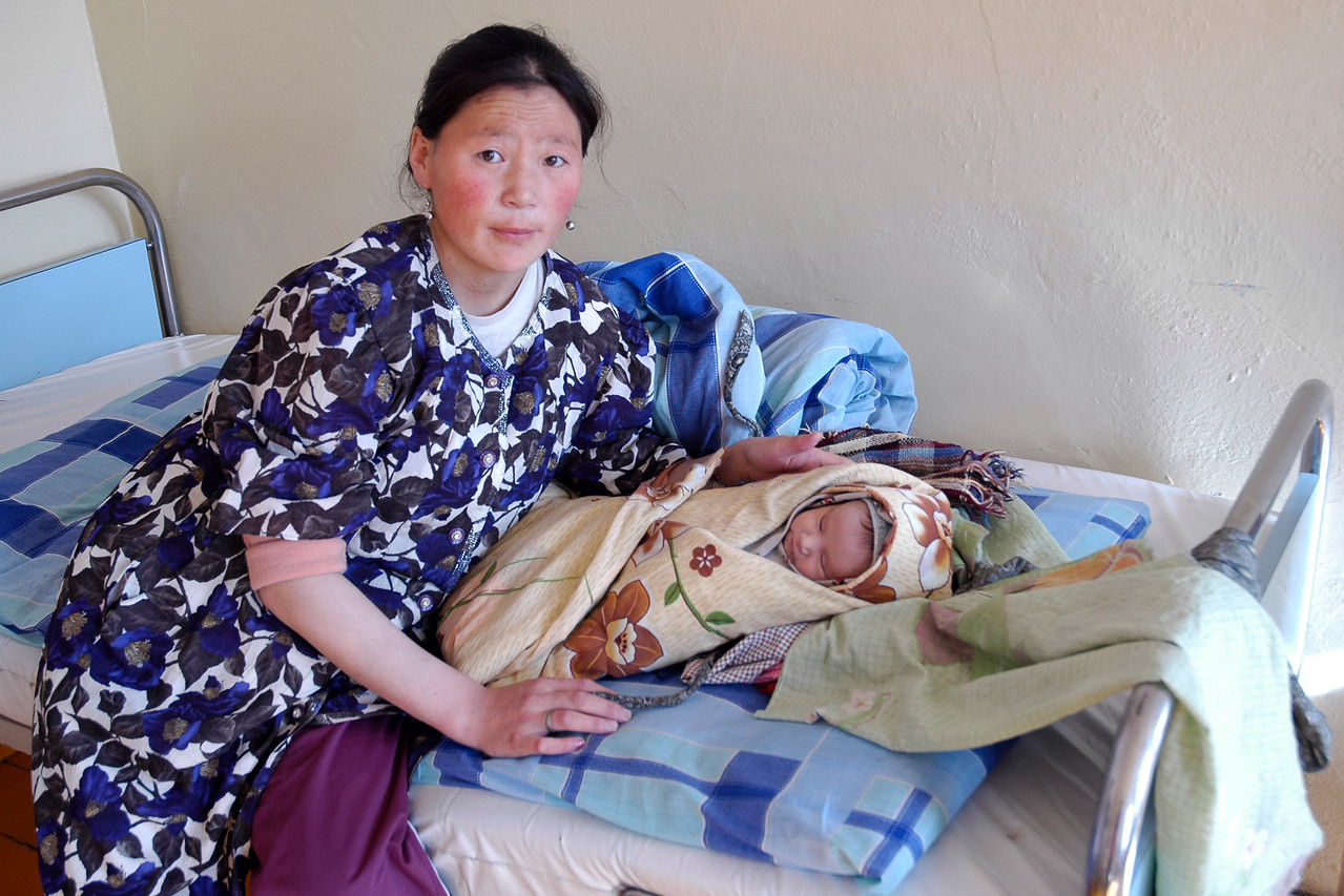 Young mother gave birth to the child and had come for a check-up. Seen while reviewing the systems and e-health facillities in Central Mongolia with Dr. Amarsaikhan Dash, and Batpurev.