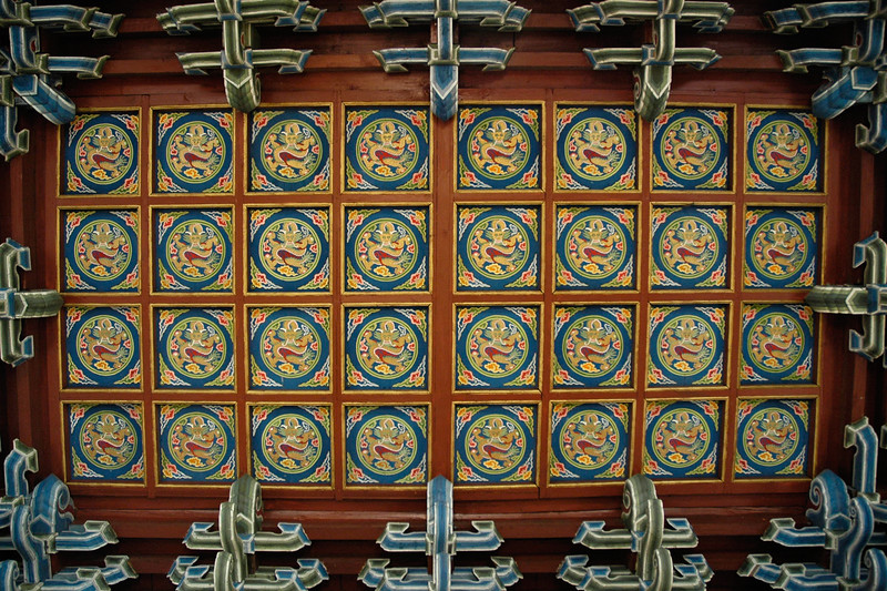 Intricate work done on the wooden ceiling with Buddhist inscriptions. Gandan Monastery is one of the most significant ones in Mongolia. UB, Ulaan Baator, Mongolia.