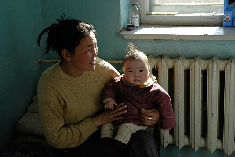 Small mongolian child with mother in Central Mongolia.
