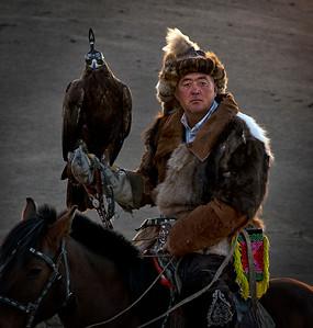 Kazakh eagle hunter and his bird.
