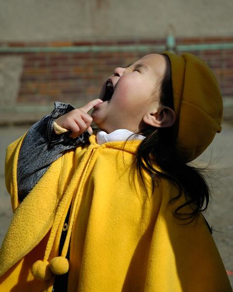 Smiling little girl outside Health Sciences University of Mongolia, Ulaanbataar.
