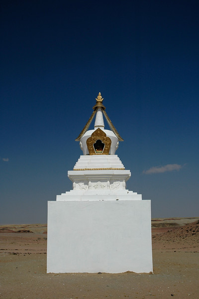 Gobi desert: stupa in the desert. Buddhist prayer mount and prayer area. Some tourists especially Japanese come to this area to offer prayers. Center of energy, towards Khamariin Khiid Monastary in Dornogobi, Mongolia.