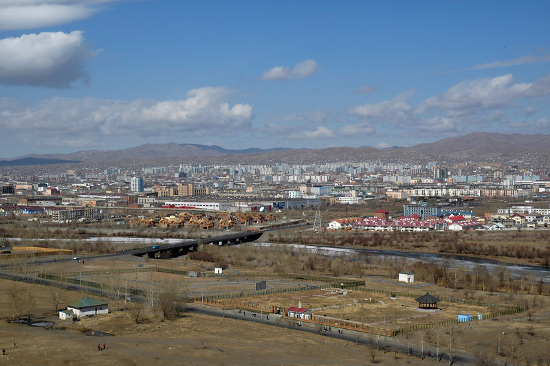 Ariel view of UB (Ulaan Baator), Mongolia from Zaisan Hill. Zaisan Hill Memorial was erected on the occasion of 50th anniversary of Mongolia Independence and honors the Soviet and Mongolian soldiers who died in WWII in the fight against Japan and Nazi Germany. The Memorial provides impressive view over the whole capital city.