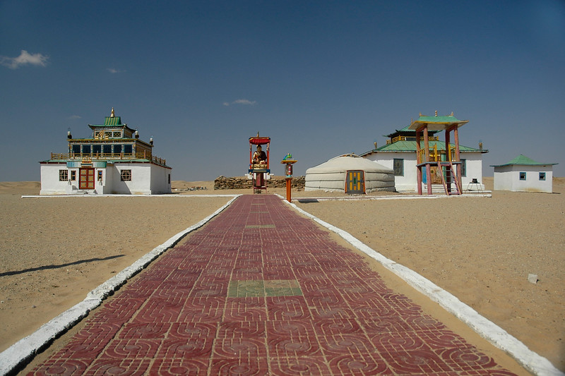 "Buddhist temple and stupa in Gobi desert, Mongolia. Almost as if a non-man land this cluster was an oasis in the desert.<br /> <br /> Khamar Monastery was established in the 1820's by famous 19th century Mongolian educator and literary figure Danzanravjaa. The Monastery was an important centre of the Buddhist ""red sect"", and seat of the Gobiin Dogshin Noyon Khutagt (""Terrible Noble Saint of the Gobi"")."