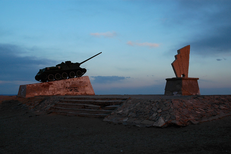 Russian tank captured and put on display on top of a hill betwen Arshand and Uvurshand together called Saishand. Gobi Desert, Mongolia.