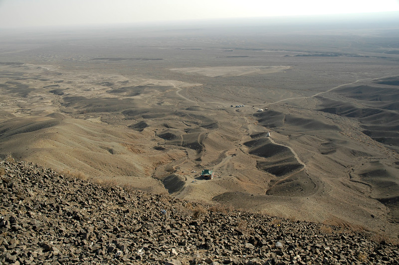 """View from the top was pretty amazing. Looked more like a lunar surface than our """"blue planet"""". You see the mid-point prayer area as well as the ger and where the cars are parked. Quite a climb!"""