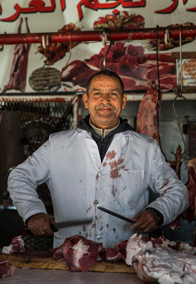 A butcher in a street stall. <br /> <br /> Er-Rich, Morocco, 2018