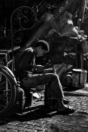 Metal worker inside the Medina.  Marrakesh 2010.