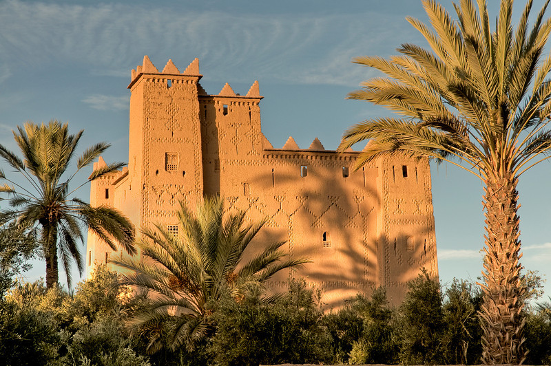 A kasbah was a place for the local leader to live and as a defense when the city was under attack. A kasbah has high walls which usually have no windows. Sometimes, they were built on the top of hills to make them easier to defend. Some of them were also placed near the entrance of harbors. Having a kasbah built was a sign of wealth of some families in the city. Almost all cities had their kasbah, this building being something necessary for the city to survive. <br /> <br /> Kasbah Ait Abu, Skoura, Morocco, 2010.