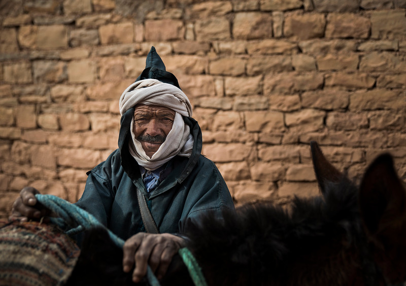 Local man and his donkey.<br /> <br /> Tamtetoucht, Morocco, 2018.