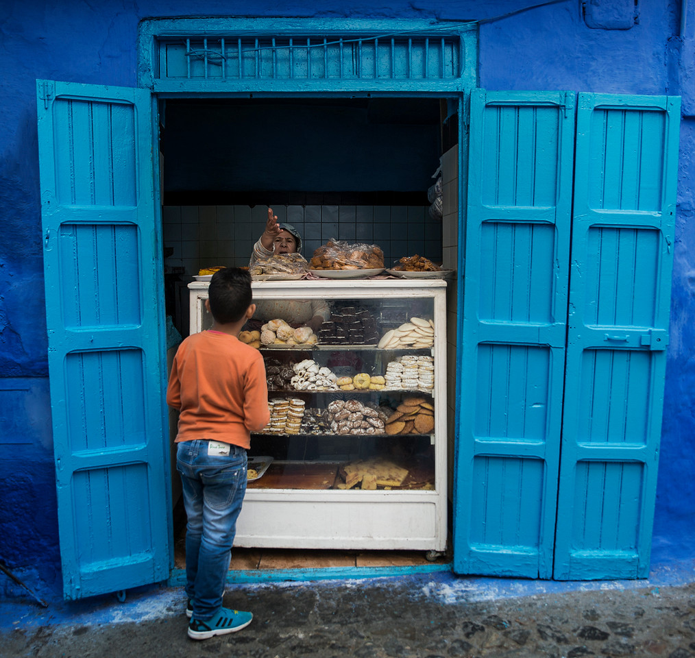 A boy shopping sweets in Chefchaouen.<br /> <br /> Chefchaouen, Morocco, 2018
