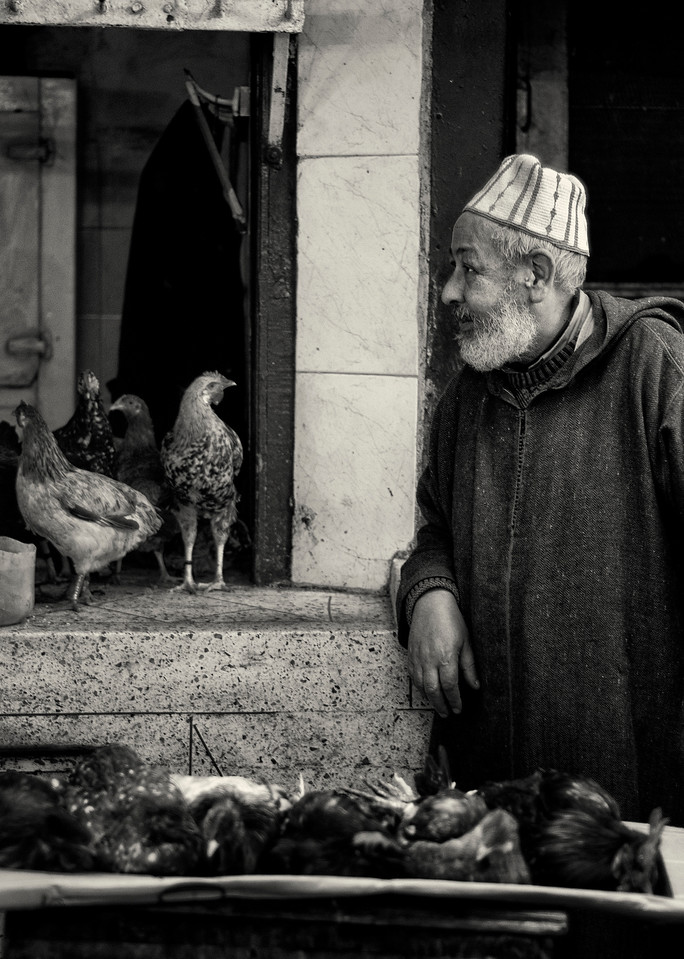 Man talking to his chicken ? Inside the Medina.<br /> <br /> Marrakesh, Morocco, 2010.
