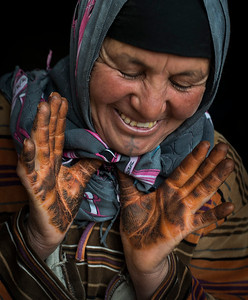 Berber woman from the high Atlas with henna on her hands.  Tamtetoucht, Morocco, 2018.