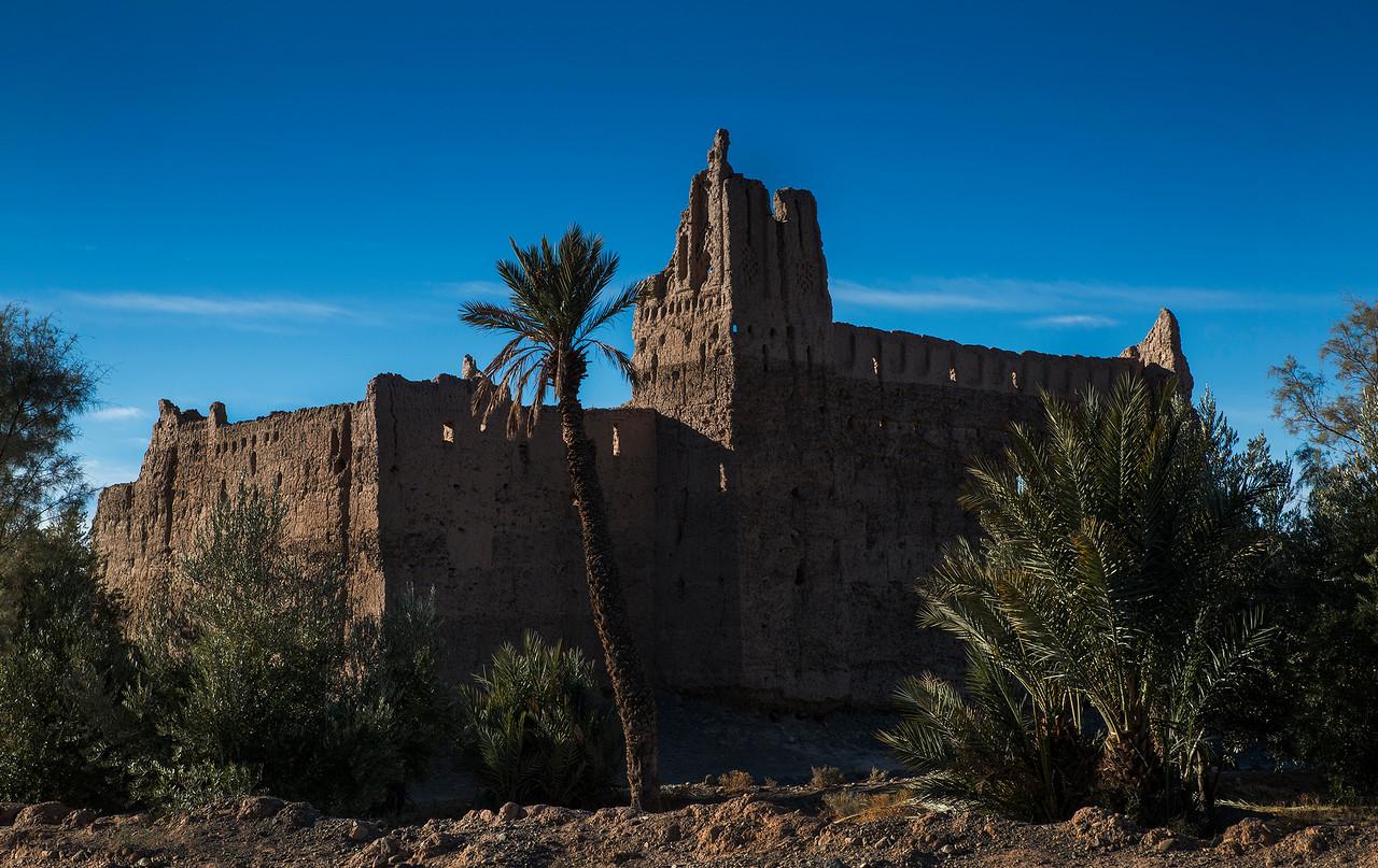 One of many ruined Ksar found inside the beautiful Skoura  palmeraie.<br /> <br /> Skoura, Morocco, 2018.