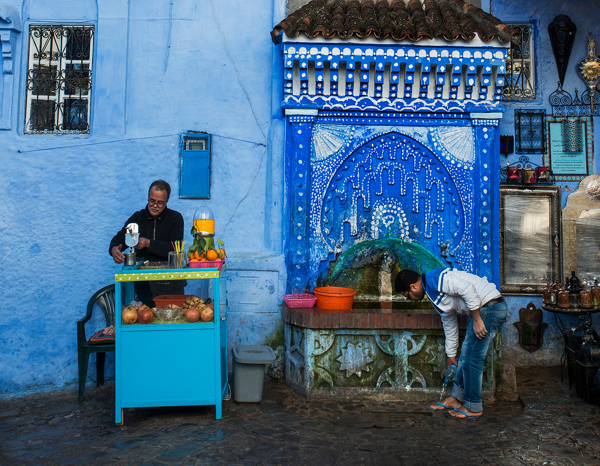 Street scene in the blue city of Chefchaouen.<br /> <br /> Chefchaouen, Morocco, 2018.
