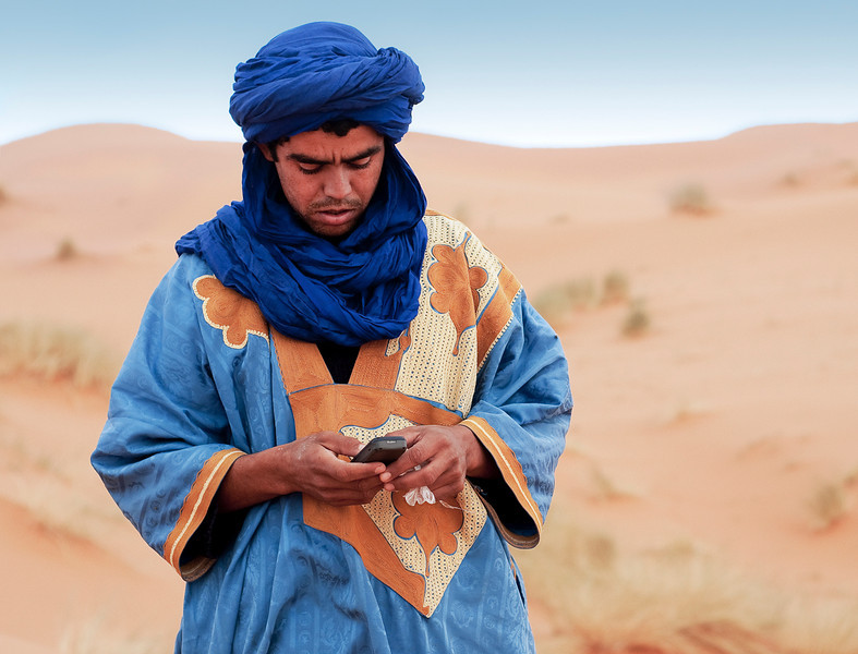Bedouin in the Erg Chebbi sand dunes.<br /> <br /> Southern, Morocco, 2010.