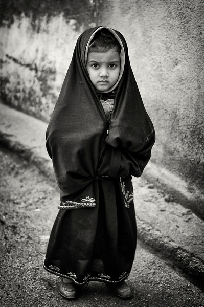 Small girl in the village of Tafaoute.<br /> <br /> Southern Morocco, 2010.