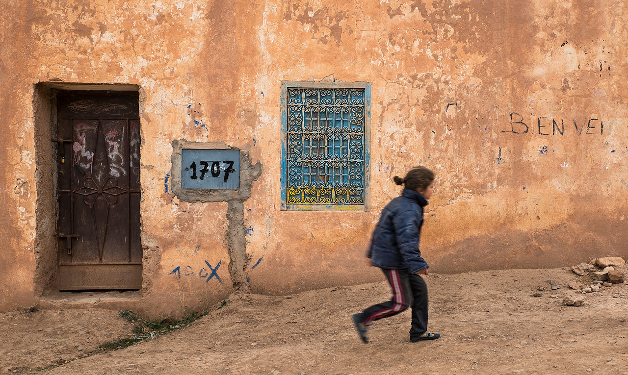 girl walking in the streets of a small village high up in the Atlas mountains.<br /> <br /> morocco, 2018.
