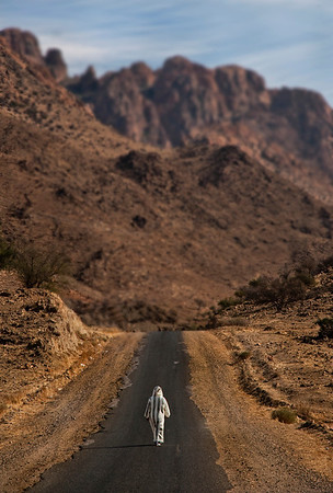 lonely man walking between villages close to the village of Tafraoute.   Southern Morocco, 2009