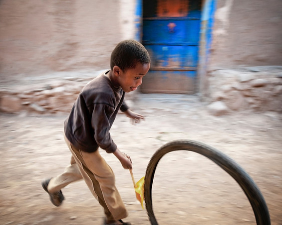 Commercial toys are not easily found in the small towns. Here children use there imagination and create there own.   Agdz, Morocco, 2010