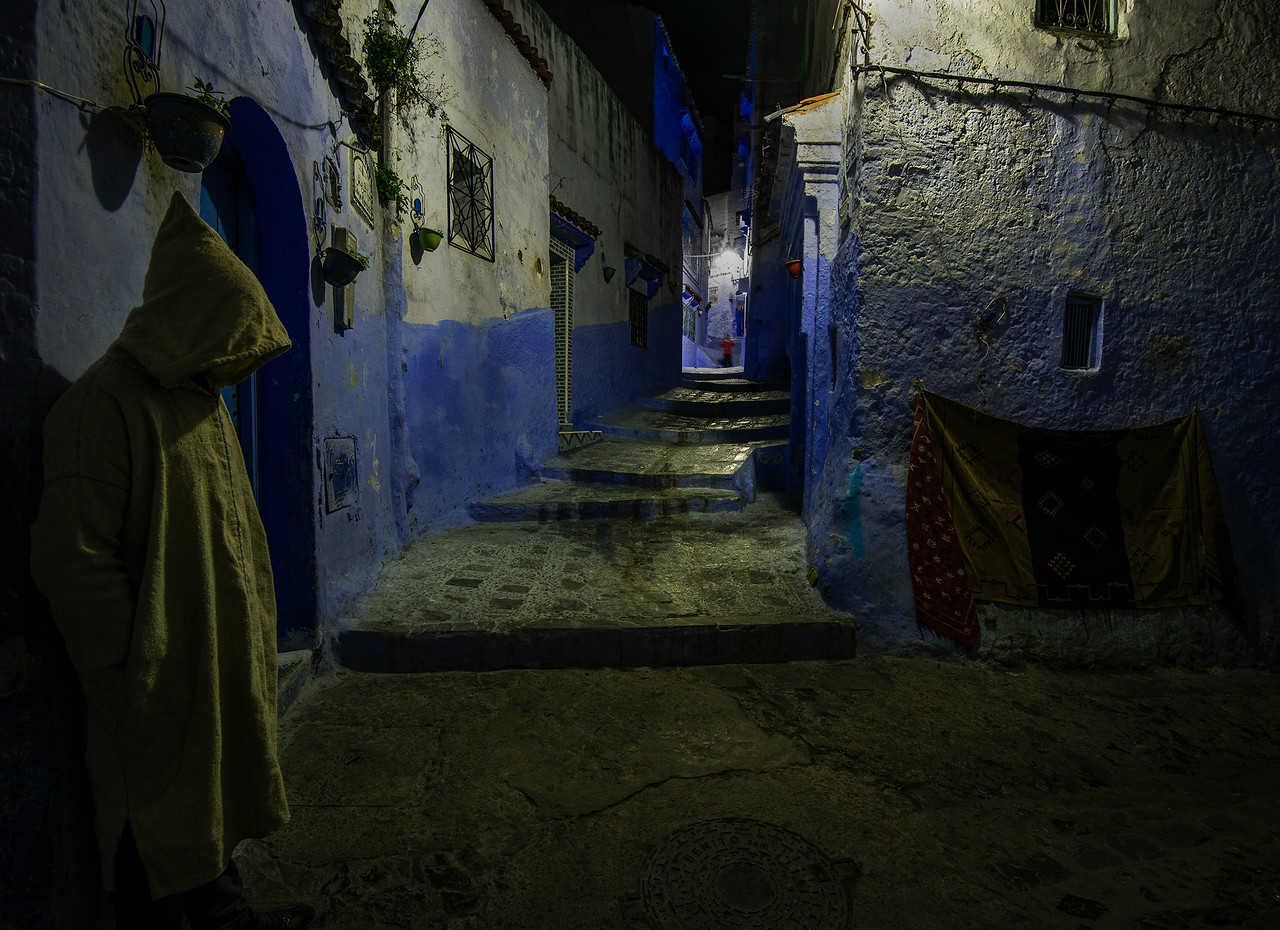 The narrow alleyways of the old medina can be an eerie place at night.<br /> <br /> Chefchaouen, Morocco, 2018
