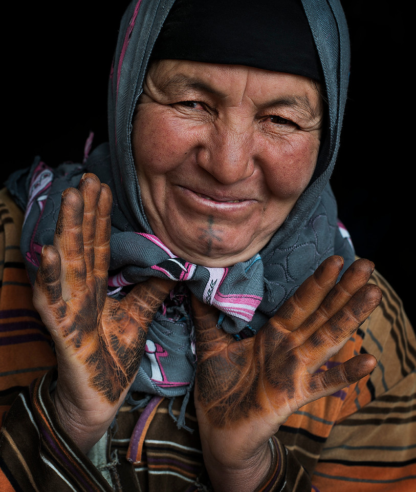 Berber woman from the high Atlas with henna on her hands.<br /> <br /> Tamtetoucht, Morocco, 2018.