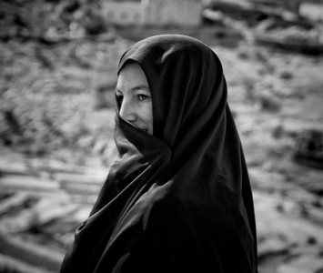 Shy Berber woman covering up her smile.   Ameln Valley, Morocco, 2010