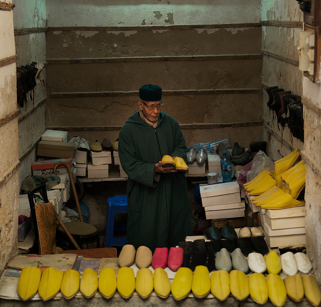Shop selling the traditional Moroccan slippers.<br /> <br /> Fez, Morocco, 2018.