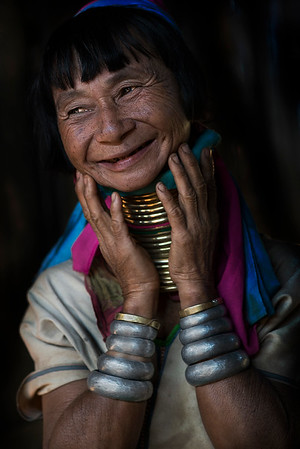 Women of the Kayan tribes identify themselves by their forms of dress. Women are well known for wearing neck rings, brass coils that are placed around the neck, appearing to lengthen it.   Girls first start to wear rings when they are around 5 years old. Over the years, the coil is replaced by a longer one and more turns are added. The weight of the brass pushes the collar bone down and compresses the rib cage. The neck itself is not lengthened; the appearance of a stretched neck is created by the deformation of the clavicle.  Kayah state, Myanmar, 2017