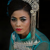 Portrait of a woman dressed in traditional clothing for her sons novice initiation ceremony.<br /> <br /> Myanmar 2017