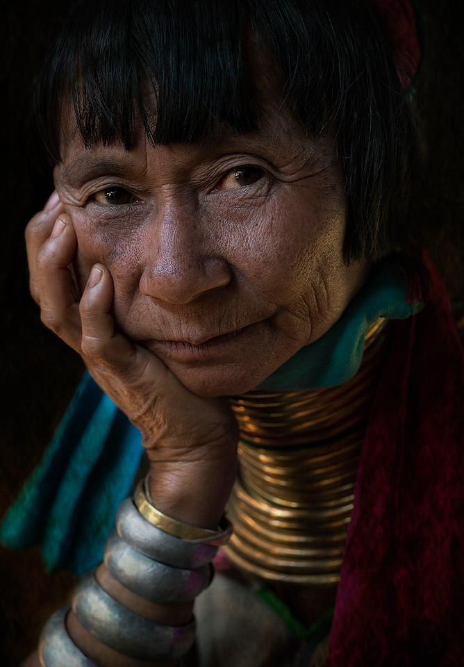 Portrait of a Kayan woman showing the traditional neck rings and bracelet. <br /> <br /> Kayah State, Myanmar, 2017