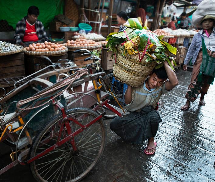 Street scene at the food market in Mandalay.<br /> Mandalay, Myanmar, 2017.