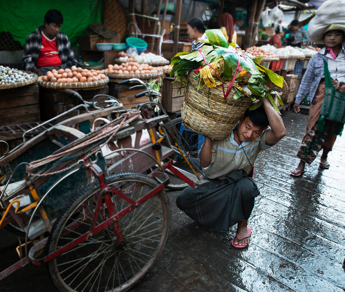 Street scene at the food market in Mandalay.<br /> Mandalay, Myanmar, 2017.