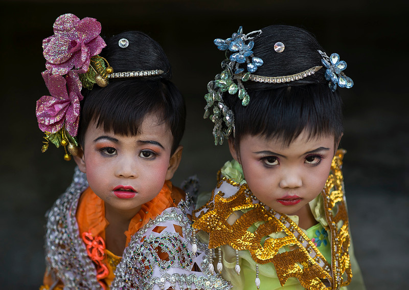 Two little girls dressed up for the novice ceremony. <br /> <br /> Myanmar.2017