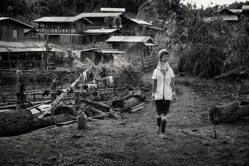 A Kayan lady walking through her village.<br /> <br /> Kayah State, Myanmar.