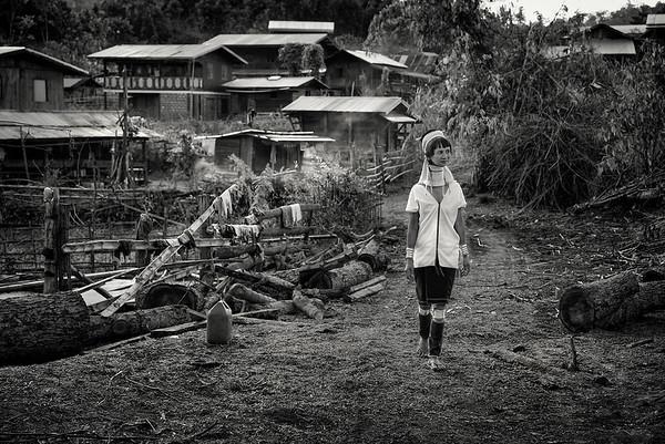 A Kayan lady walking through her village.  Kayah State, Myanmar.