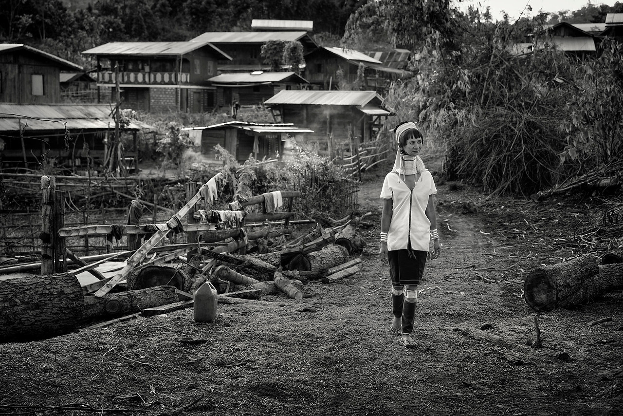 A Kayan lady walking through her village.<br /> <br /> Kayah State, Myanmar.