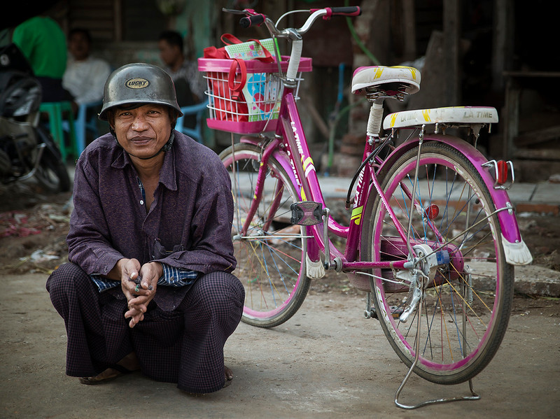 A man with a pink bicycle at the food Market in Mandalay, Myanmar.