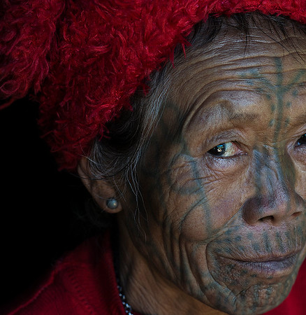 Bu Pai is around 60 years old and lives with her son and extended family ever since her husband died a few years back. Bu is from the Muun tribe, easily distinguishable by the inverted D tattooed on her face.  Bu had her face tattooed in her early teens and still recalls the pain she went through.