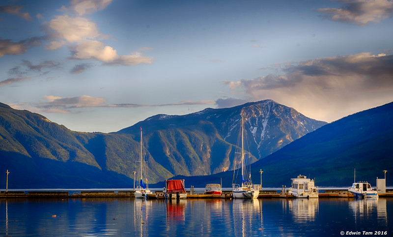 Sunset over moored boats - Nakusp Marina.