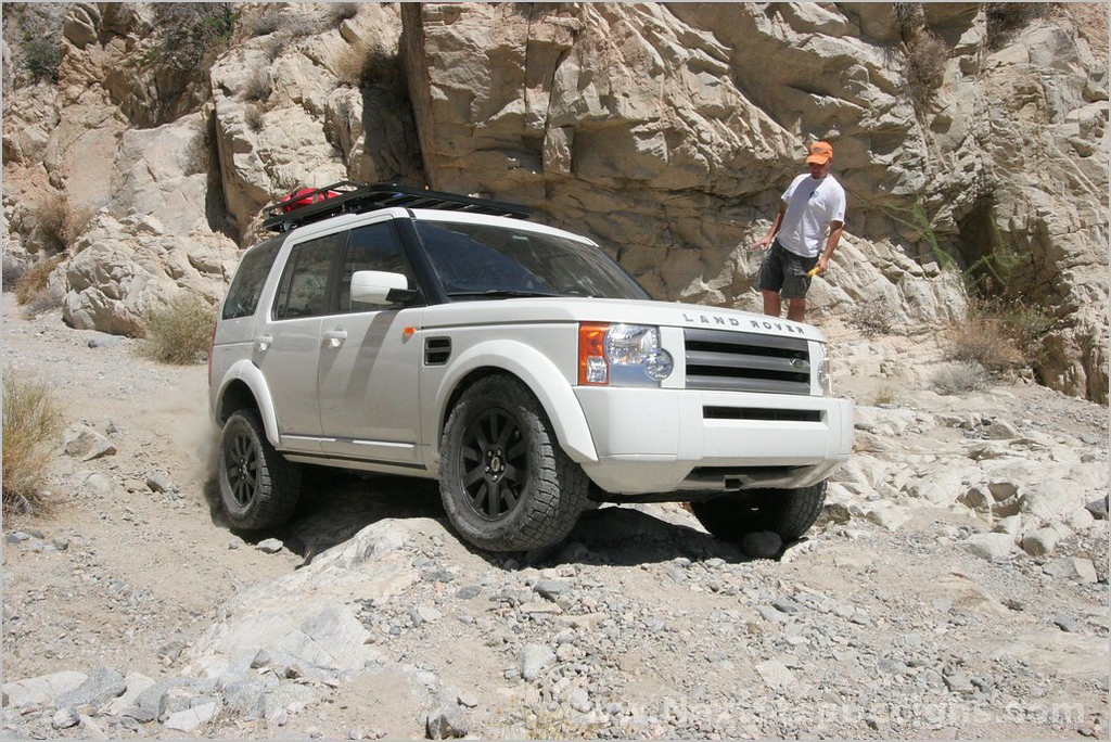 Hung up on a rock, resting on the fuel tank skid plate.  Not the proper line for a modern Rover.