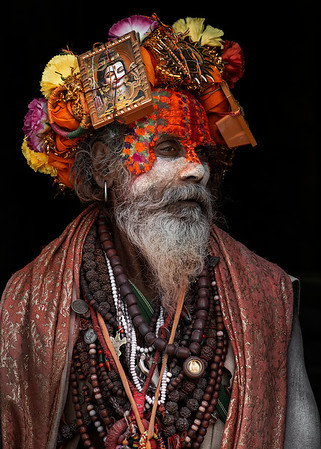 The processes and rituals of becoming a sadhu vary with sect; in almost all sects, a sadhu is initiated by a guru, who bestows upon the initiate a new name, as well as a mantra, (or sacred sound or phrase), which is generally known only to the sadhu and the guru and may be repeated by the initiate as part of meditative practice.  Becoming a sadhu is a path followed by millions. It is supposed to be the fourth phase in a Hindu's life, after studies, being a father and a pilgrim, but for most it is not a practical option. For a person to become sadhu needs vairagya. Vairagya means desire to achieve something by leaving the world (cutting familial, societal and earthly attachments).  A person who wants to become sadhu must first seek a guru. There, he or she must perform guruseva which means service. The guru decides whether the person is eligible to take sannyasa by observing the sisya (the person who wants to become a sadhu or sanyasi). If the person is eligible, guru upadesa (which means teachings) is done. Only then, the person transforms into sanyasi or sadhu. There are different types of sanyasis in India who follow different sampradya. But, all sadhus have a common goal: attaining moksha.  Kathmandu, Nepal, 2019