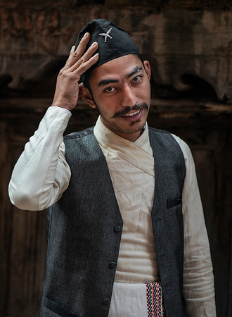 A young man dressed in traditional Newari clothing.   Bhaktapur, Nepal, 2019