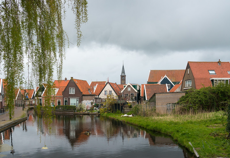 Dutch houses and their reflection. Volendam, Netherlands near Amsterdam.