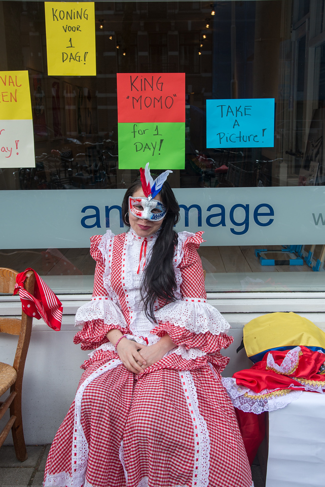 "Lady with a ""take a picture"" sign on King's Day (formerly Queen's Day) in Amsterdam.<br /> <br /> King's Day 2016 - Koningsdag 2016 is the Dutch national holiday held on Wednesday 27 April 2016. Following the abdication of Queen Beatrix in 2013 and the inauguration of King Willem-Alexander, Queen's Day (30 April, the birthday of former Queen Juliana) has become King's Day (27 April, birthday of Willem-Alexander). One of the main highlights of King's Day is the citywide free market (vrijmarkt)."