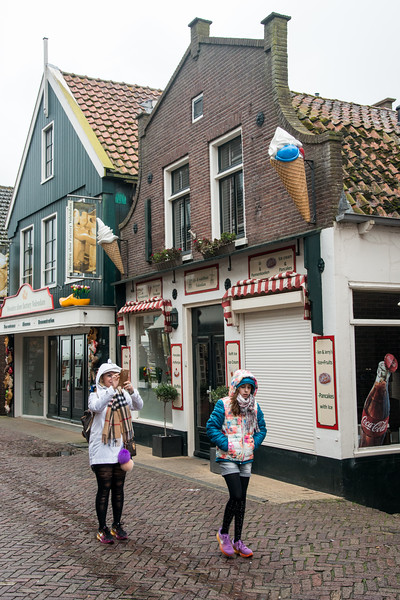 Visitors at water-front shops as well as restaurants at Volendam, Netherlands near Amsterdam.