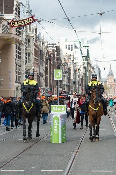 The Mayor and spouse with horse escort on the streets on King's Day (formerly Queen's Day) festivities in Amsterdam, Netherlands, Europe.